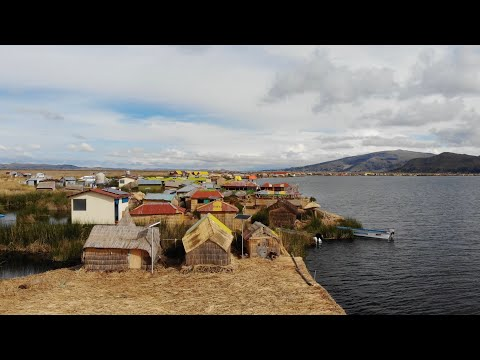 Exploring The Uros Floating Islands At Lake Titicaca In Peru